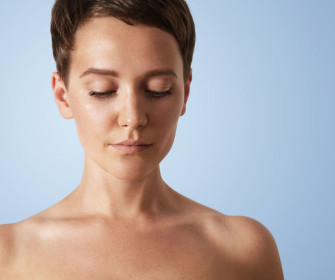 62423089 - woman with a clean skin on a blue background
